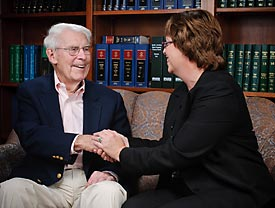 Ginger Rouse with Chuck, an Investors Trust Client